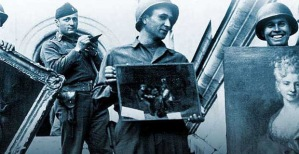 photo of WWII soldiers holding stolen art