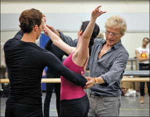 Peter Martins rehearsing Jenifer Ringer and Philip Neal. Jared Angle looks on. Peter Martins Reh. NYCB New John Adams Ballet Sept. 25, 2009 Credit Photo: ©Paul Kolnik studio@paulkolnik.com